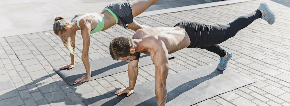 fit-fitness-woman-man-doing-fitness-exercises-outdoors-city
