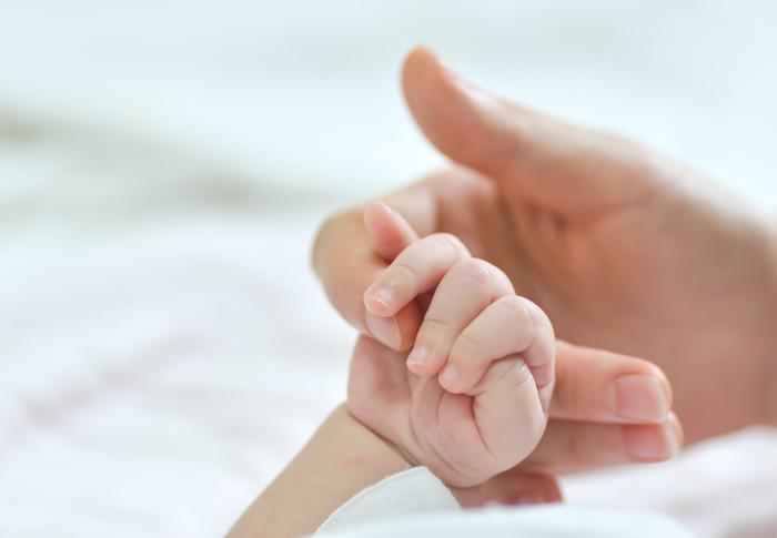 Die Hand eines Babys