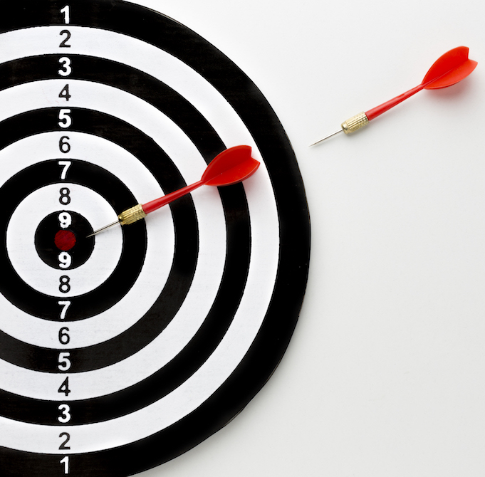 top-view-arrows-going-towards-bullseye